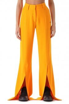 Удлиненные брюки с разрезами